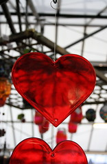 Hanging By A Thread (Everest Ruby) Tags: red glass hearts heart center glossy string hanging fragile brightred knutsford gardencenter