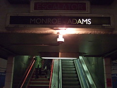 Monroe & Adams (crowbert) Tags: woman chicago green lightbulb stairs cta adams loop coat escalator theel signage monroe theloop helvetica redline conduit thel chicagotransitauthority