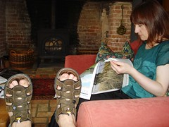 Centurian by the fire place (Gezlarge) Tags: travel brick feet work fireplace roman sandals room front guardian supplement