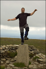 Crouching Trigpoint, Hurting Shin (chimpaction) Tags: mountain d50 scotland nikon perthshire summit graham munro trigpoint drumochterpass sgairneachmhor