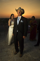that hat (hackett) Tags: wedding sunset portrait sky orange colors sanantonio cowboy texas boots tie suit guest cowboyhat fashionable hackett pocketsquare strobist claytonhackett thebushnell