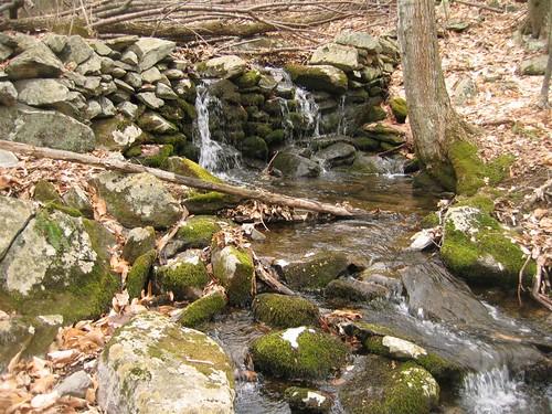 Gentle waterfall over stone wall
