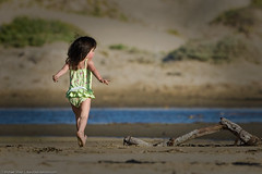 Small child runs on Morro Strand