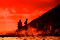 splash joke (Tasslehoff Burrfoot) Tags: sunset sea people beach clouds swimming 2470f28 altinoluk cokinfilters