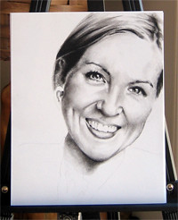 In progress photo of carbon pencil drawing entitled Ashley