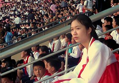 Our NK tour guide: Miss Wen (ShanLuPhoto) Tags: idea day tour kim stadium propaganda flag north games korea il communism national gymnastics leader hanbok guide mass dear socialism jong pyongyang sung dprk  arirang juche