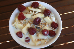 Cereal bowl with apple, raspberries & soy milk