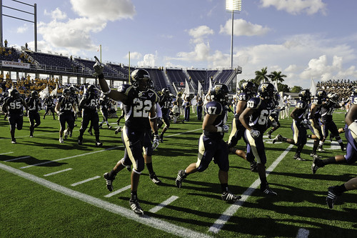 football players running. FIU Football players running