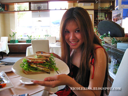 posing with club sandwich