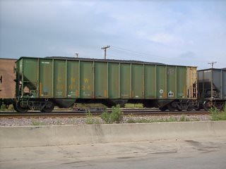 A former Chicago & NorthWestern Railroad coal hopper car in transit. Chicago Illinois. August 2007.