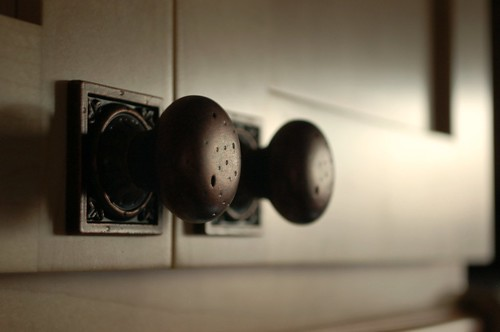 Closeup of cabinet pulls in low light
