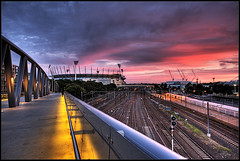 MCG sunset (Luke Tscharke) Tags: longexposure bridge pink light sunset red sky night digital canon eos lights footbridge dusk painted tracks railway australia melbourne william victoria colourful 2008 hdr mcg xsi barack sigma1020mm melbourneskyline 450d digitalrebelxsi lushaki luketscharke