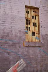 Window (Daria Angeli) Tags: nyc usa window brooklyn graffiti iron bricks holes williamsburg mauve through