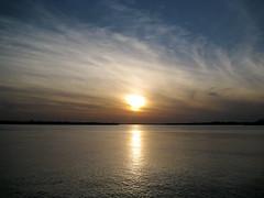 Buffalo, NY at sunset (Leya :P) Tags: blue sunset sky sun lake ny water yellow night clouds landscape buffalo calm lakeontario breeze