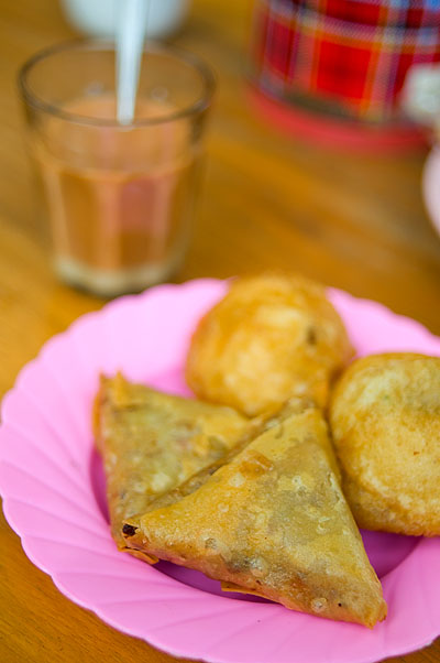 Samosas and sweet tea at Valentine tea shop, Thachilek, Shan State, Myanmar