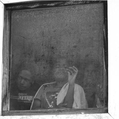 Ladies behind mosquito net (Koen Cobbaert) Tags: brussels window indonesia belgium belgique belgi bruxelles brussel muda  mosquitonet baliem wanita ninia        gadis ngi  kii papuabarat     dscf9263     koencobbaert          xs