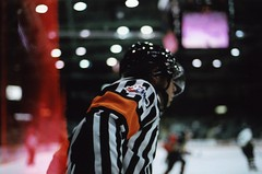 He wouldnt even look at me (derekthejoyce) Tags: camera light orange white black film ice hockey lights referee glare asahi pentax skate skates whl princegeorge