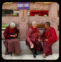Words of Silence (designldg) Tags: red people woman india smile temple buddhist religion happiness buddhism nun silence elder tibetan spiritual soe reddress bihar bodhgaya  mywinners indiasong platinumphoto ysplix hourofthesoul tff1