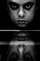 Dj pens (SurfaceSpotting) Tags: light portrait people blackandwhite bw monochrome look dark blackwhite eyes nikon shadows staring reflexion f25 humans 105mm d40 michaelides infinestyle d40x surfacespotting georgemichaelides djpens