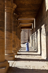 Contemplating Isis (Trouvaille Blue) Tags: africa travel light ancient shadows columns egypt middleeast unesco relief egyptian pillars aswan isis colonnade jalaba pharoh ptolemy templeofphilae trouvailleblue