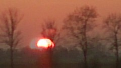 Moving sunset (from the train) (knehte(r)gek) Tags: sunset red orange blur tree window mobile train landscape zonsondergang move moved trein bewogen shaken