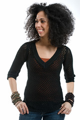 Beautiful Young African-American woman with afro (jackie weisberg) Tags: girls portrait woman girl beautiful smiling female laughing portraits hair happy beads women image afro curls bighair exotic curly photograph american africanamerican females ethnic curlyhair baubles greathair colorimage modelreleased fishnettop jackieweisberg