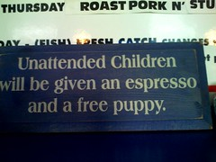Unattended children will be given an espresso and a free puppy - sign