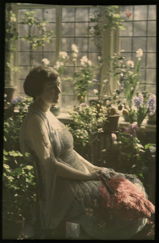 Woman in greenhouse