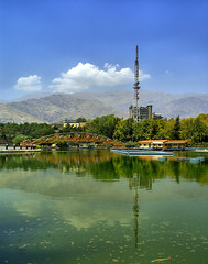Mellat Park Lake in Summer, Tehran, Persia (Iran) (eshare) Tags: park bridge trees sky cloud mountain lake mountains reflection clouds landscape persian iran lakes bridges gimp persia iranian tehran  hdr highdynamicrange iranians teheran  persians     mellatpark      kakadoo hdrfromasingleraw sonyalphadslra100    sal20f28 shutterspeed1400sec dynamicphotohdrsoftware  dphdr   100 diaphragmvaluef80 sonyalpha20mmf28lens 2028