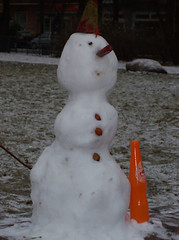 Snowman with orange bottle