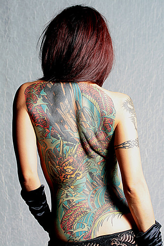 tribal dragon tattoos for girls. Sexy back dragon tattoos for girls