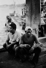 Island boys, what lies ahead (000032) (Fadzly @ Shutterhack) Tags: street travel vacation portrait people blackandwhite bw holiday hot film nature boys monochrome analog yard port writing catchycolors asian blackwhite lyrics interestingness fishing fisherman dock nikon marine asia poem fishermen noiretblanc kodak song trix photojournalism documentary literature human 400 malaysia sit tropical tropic rest column kuala write analogue grayscale nikonfm2 asean terengganu equator humid 50mmf14ai blancinegre mys interpretation mensen    kodaktrix400  maleisi  mennesker explored  sooc nikonstunninggallery cendering chendering 100bestbwphotojournalism shutterhack