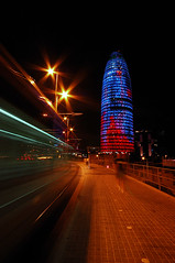 Agbar Tower by night (Daniele Dal Monte) Tags: barcelona new city blue windows red sky urban cloud color reflection building tower art glass architecture modern night facade scrapers skyscraper penis corporate design spain colorful europe european torre technology exterior shine jean tech crystal landmark catalonia business future tall shape toned futuristic offices bold nouvel agbar danieledalmonte