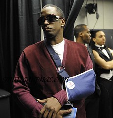 diddy posing with his arm in a sling