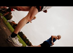 Getting Down To It. (eyedeebee) Tags: blue red grass fun nikon october shot angle legs marathon cardiff sigma running run sneakers trainers half fields runners shorts vest 2008 19 d2 angled d2h llandaff digitalcameraclub