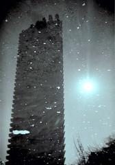 Lauderdale Tower reflected in water (MsJannifur) Tags: lauderdaletower plasticlens thebarbican holga135