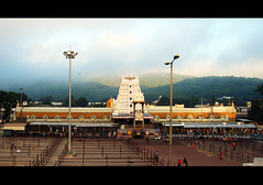 Tirupati Venkateswara Temple,Tirupati (SenShots / Senthilmani's Photography) Tags: old sky india clouds canon religious temple photography lights one town is shrine god famous hill culture belief lord m hills divine trust strong tradition spiritual hindu andhra powerful tamil tamilnadu almighty hindutemple southindia tirupati olden gopuram oneness located govinda andhrapradesh sevenhills holyplace tirumala perumal senthil venkateswara southtemple divyadesam religiousplace msenthil templeindia indiantemples bigplace andhratemple garudar senshots 108divyadesam armsenthil southindi senthilmani senshotsphotography senshots2008