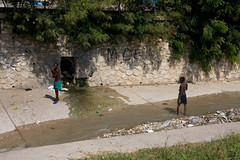 Bathing in open sewer in Port-au-Prince (Andrew Welch Photography) Tags: haiti voodoo portauprince voodou guede gud