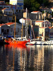 Red boat, Symi island (Marite2007) Tags: red seascape color colour architecture port reflections boats greek islands harbor wooden intense marine scenery bright harbour vibrant shoreline hellas vivid eu architectural greece reflected shore maritime colourful symi neoclassical redboats
