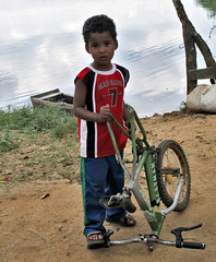 Child's play (LifeAsIPictured) Tags: boy lake water bike child lavega republicadominicana bonao countryfeelings presaderincon dominicanrepubublic lifeasipictureit