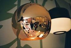 mirrorball (golfpunkgirl) Tags: holland reflection canonav1 slr film me lamp amsterdam shop fujisuperia400 av1 aischa