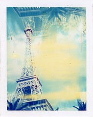 Eiffelexplosion (roostercoupon) Tags: camera blue light color tower film vintage polaroid exposure 2000 lasvegas nevada fake tint eiffel casino double resort nv 09 flare damage land type instant multiple tribute peel leak expired copy 2009 lv sincity parislasvegas 340 outdated apart packfilm lasvegasstrip iduv roidweek