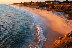 Mindarie Beach, Perth (Madi) Tags: ocean blue sunset sky cliff beach water sand nikon moments surf waves tide indianocean australia perth beaches wa westernaustralia ilovethisplace mindarie flickrchallengegroup d40x pfogold beginnerdigitalphotographychallengewinner