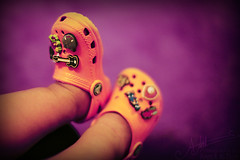 * Baby Crocs ,, (A.A.A) Tags: boy orange baby 3 cute toy toys photography shoe shoes purple little guitar sandals photograph sandal aaa qatar amna crocs irresistible jassim althani amnaaalthani