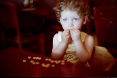 Annabel & Cheerios (Scott L.) Tags: baby 50mm fuji minolta superia f14 400 200 annabel fujisuperia x700