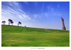 ~ (Nasser Bouhadoud) Tags: camera blue trees sky tree green tower canon garden lens landscape eos 350d flickr gulf view wide arab land nasser doha qatar aspire saher    allil  saherllil