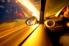 Mr. Goldfinger's ride (Toni_V) Tags: auto longexposure motion blur car topv111 gold movement nikon driving perspective mazda notripod goldfinger whiledriving d300 fastlane sigma1020mm toniv superhearts theperfectphotographer toniv callmejames 15secinmylife