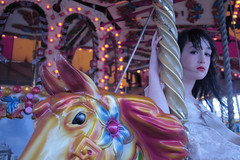 (dorellana) Tags: carnival red england horse yellow lights brighton photoshoot artistic expression elle carousel