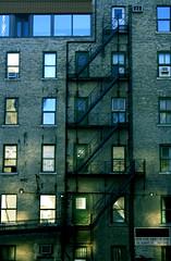 Escape (victoria.anne) Tags: windows light urban canada building brick downtown winnipeg doors shine fireescape ilovethesparklesofsunshinereflectingontothebuilding