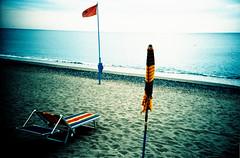 L'estate sta finendo III (Ilaria ♠) Tags: lomo lca xpro mare estate crossprocess slide lomolca genova spiaggia diapositiva kodakelitechrome100 kodakelitechrome ombrellone cogoleto toycamerafotografiaanalogicaitalia sviluppoinvertito
